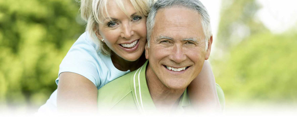 Smiling Greenwich mature couple family dentist